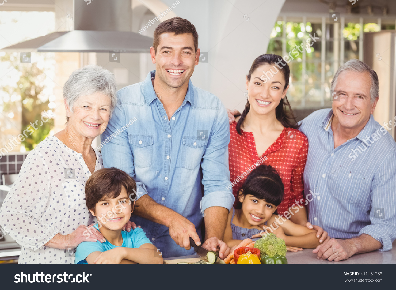 Happy family in kitchen - Portrait Of Happy Family In Kitchen At Home