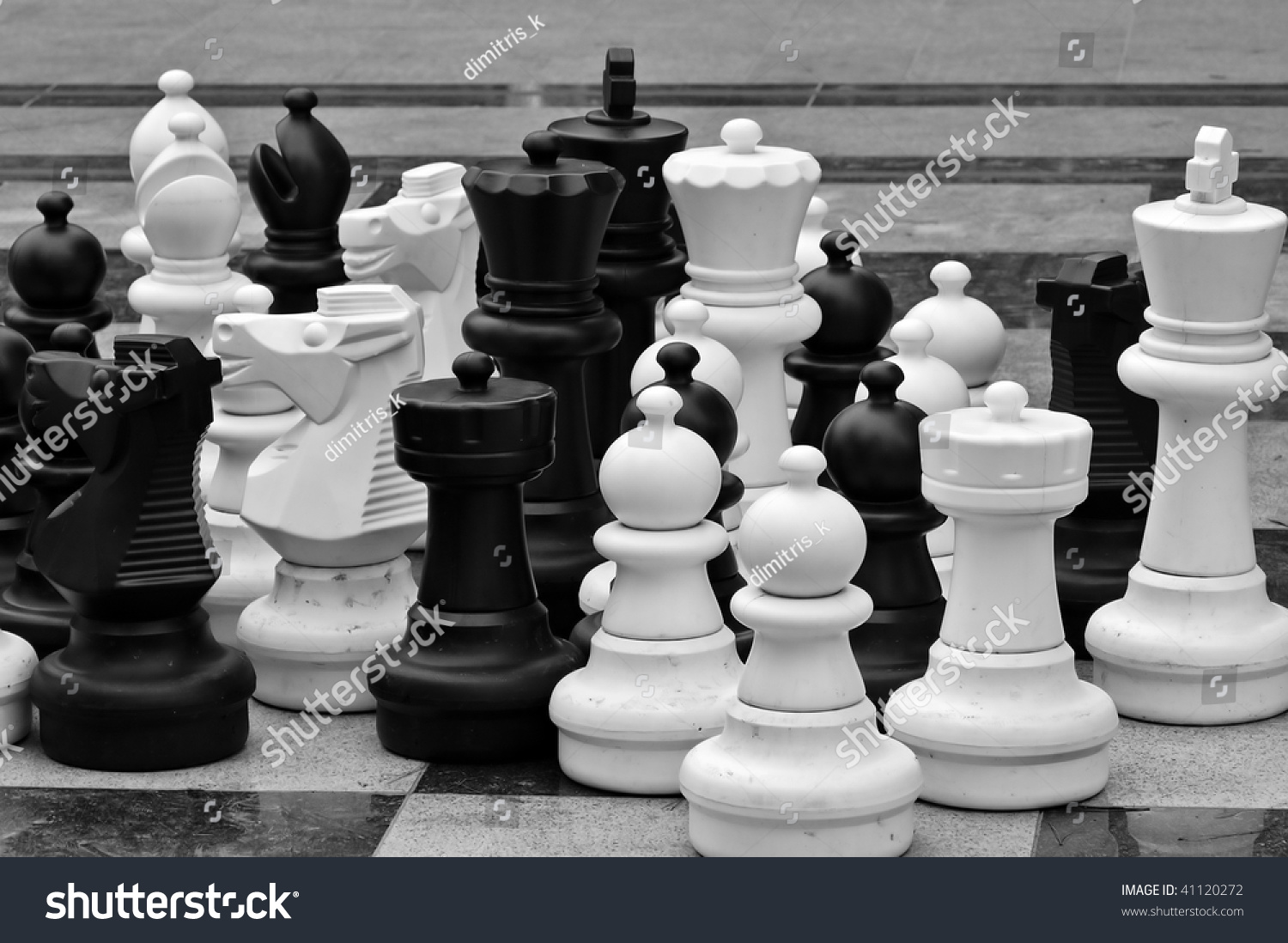 Life Size Chess Pieces And Checkered Pattern Floor Tiles