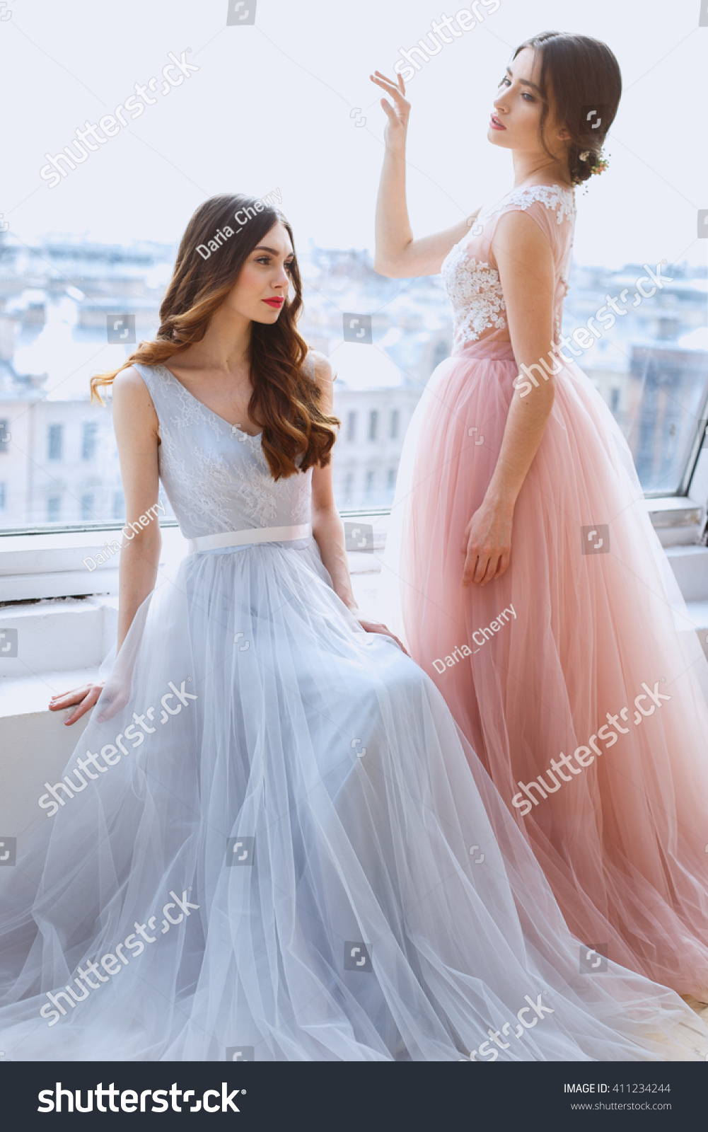 Two brides in a tender light pink and blue wedding dresses for Pink and blue wedding dresses