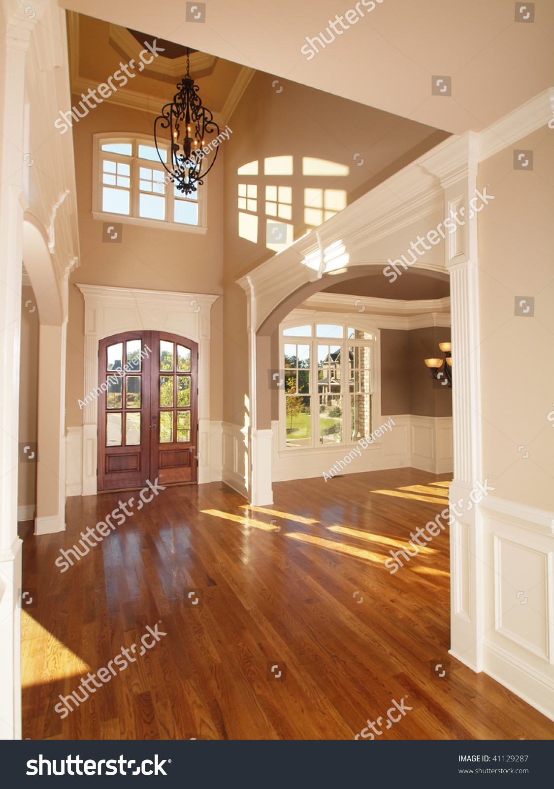 Model luxury home interior front entrance arch way stock for Model home interior photos