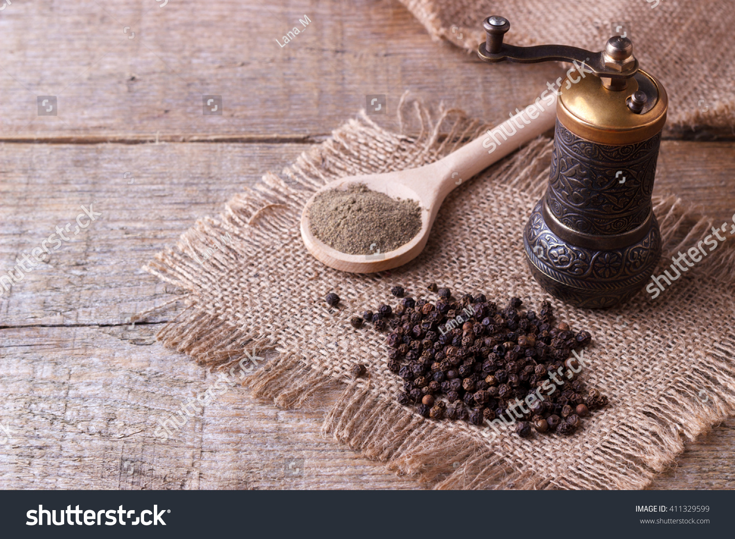 Black pepper corns and Black pepper Powder on wooden background #411329599