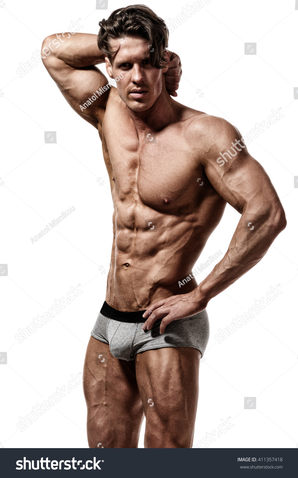Shirtless Bodybuilder Showing His Muscular Arms Isolated On White