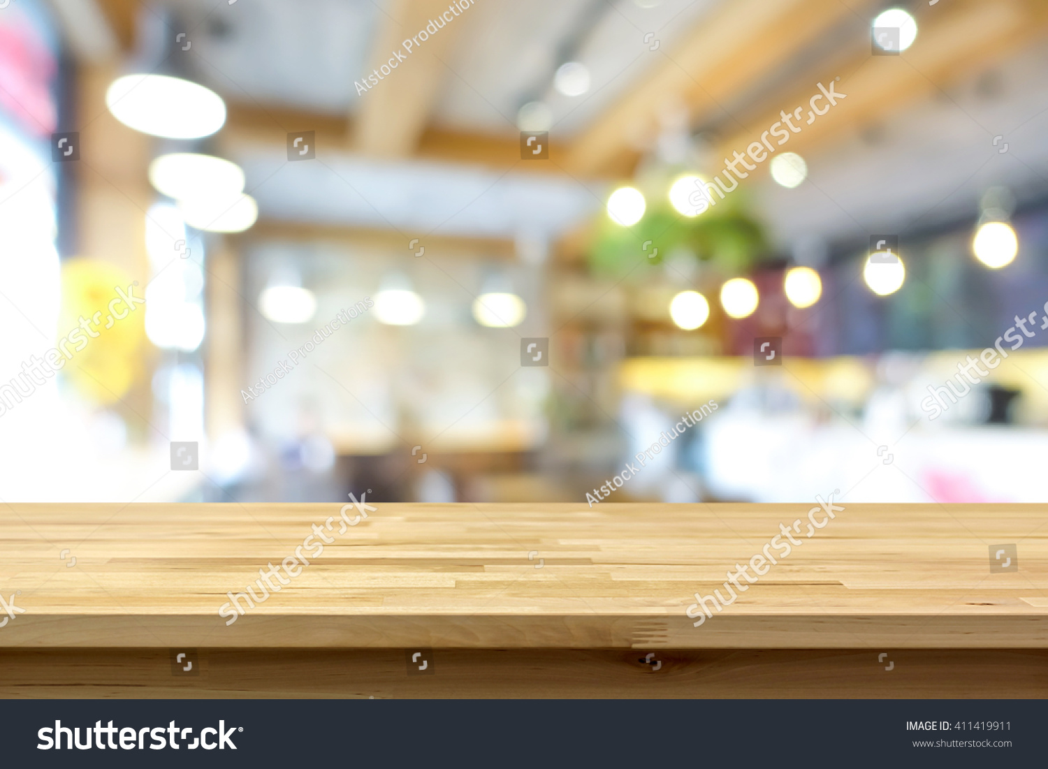 wood table top on blur background stock photo 411419911 - shutterstock