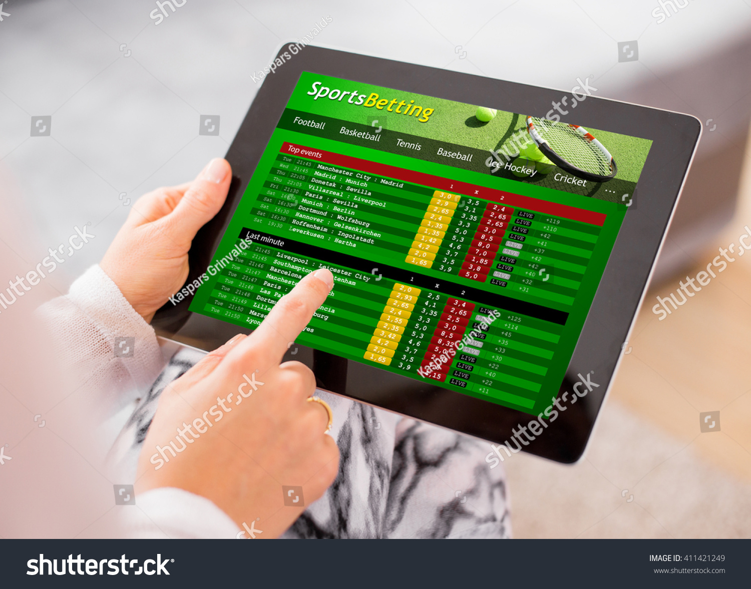 Sports betting app on tablet computer