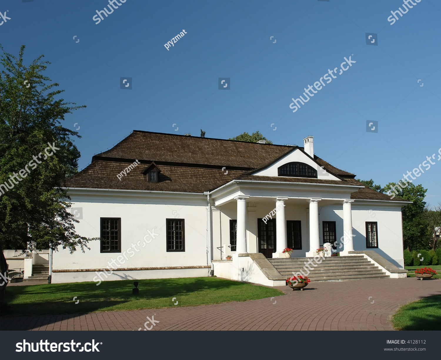 Traditional polish style manor house with white walls and wooden shingle roof stock photo - Traditional polish houses wood mastership ...