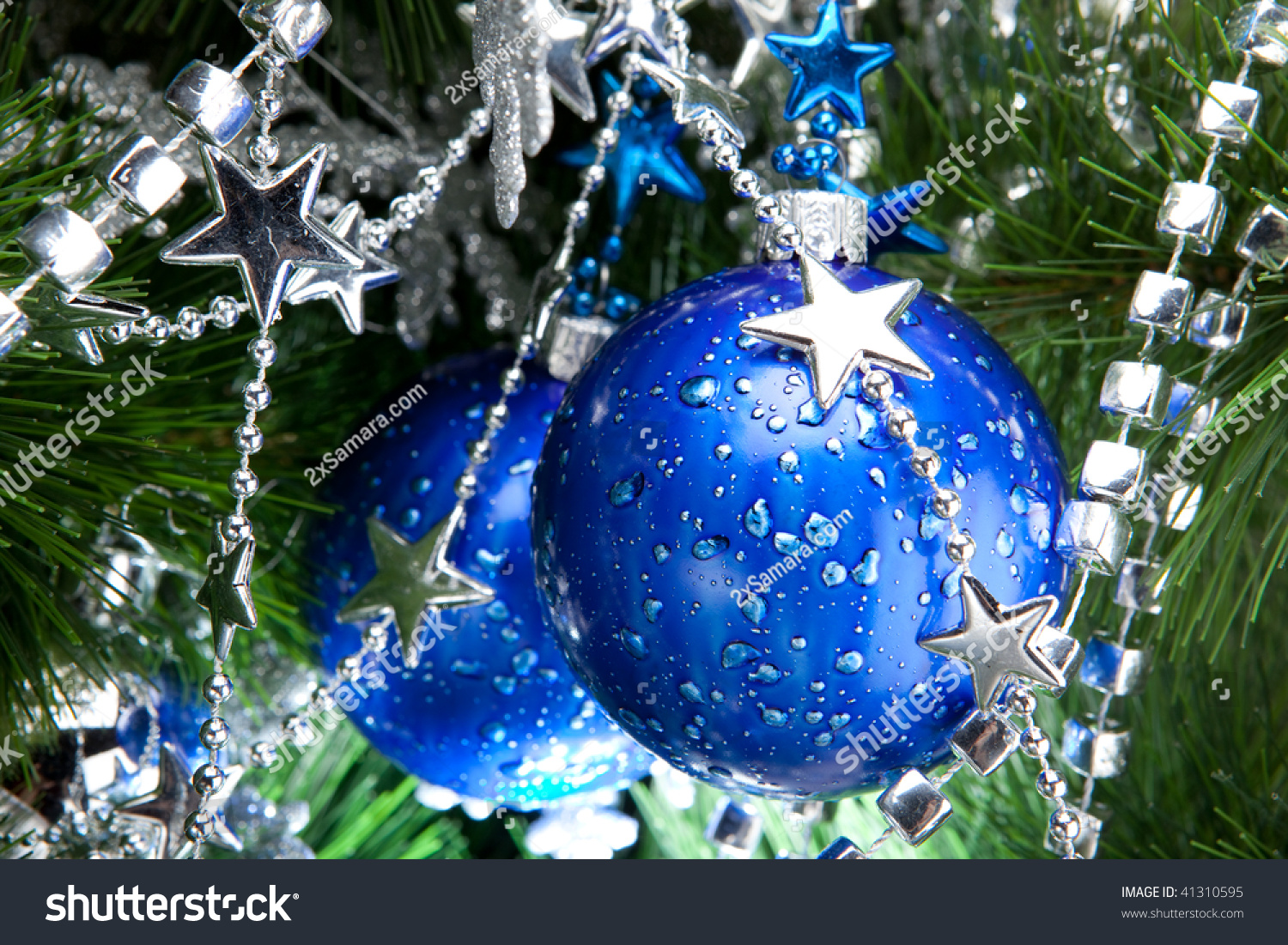 Blue Bauble With Silver Decoration On The Christmas Tree