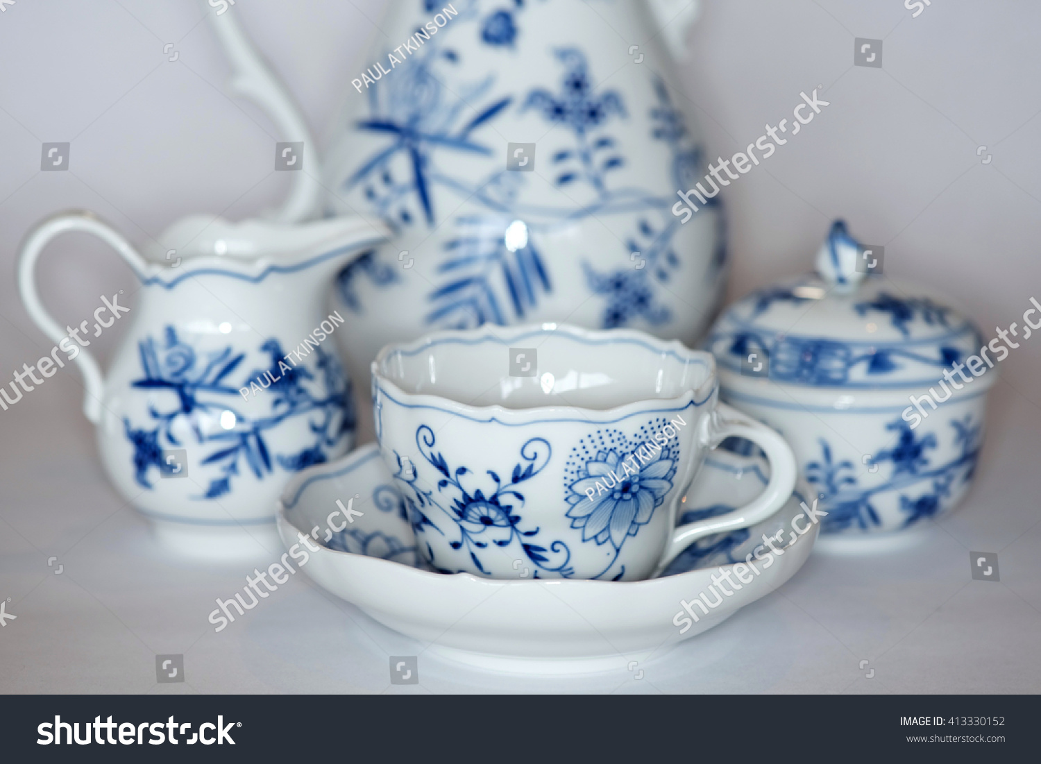 German blue white porcelain coffee service stock photo for Decorating with blue and white pottery