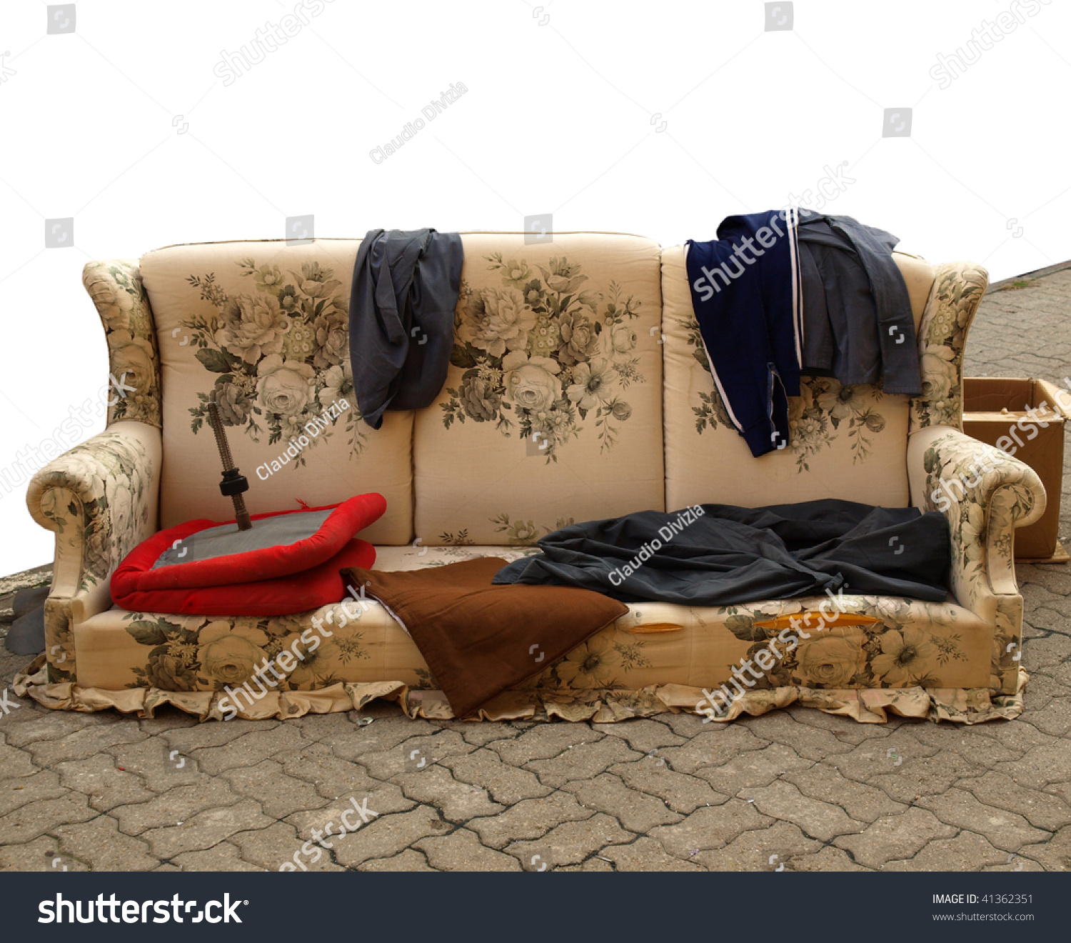 Old Sofa With Clothes Used By Poor Homeless Hobo Stock Photo