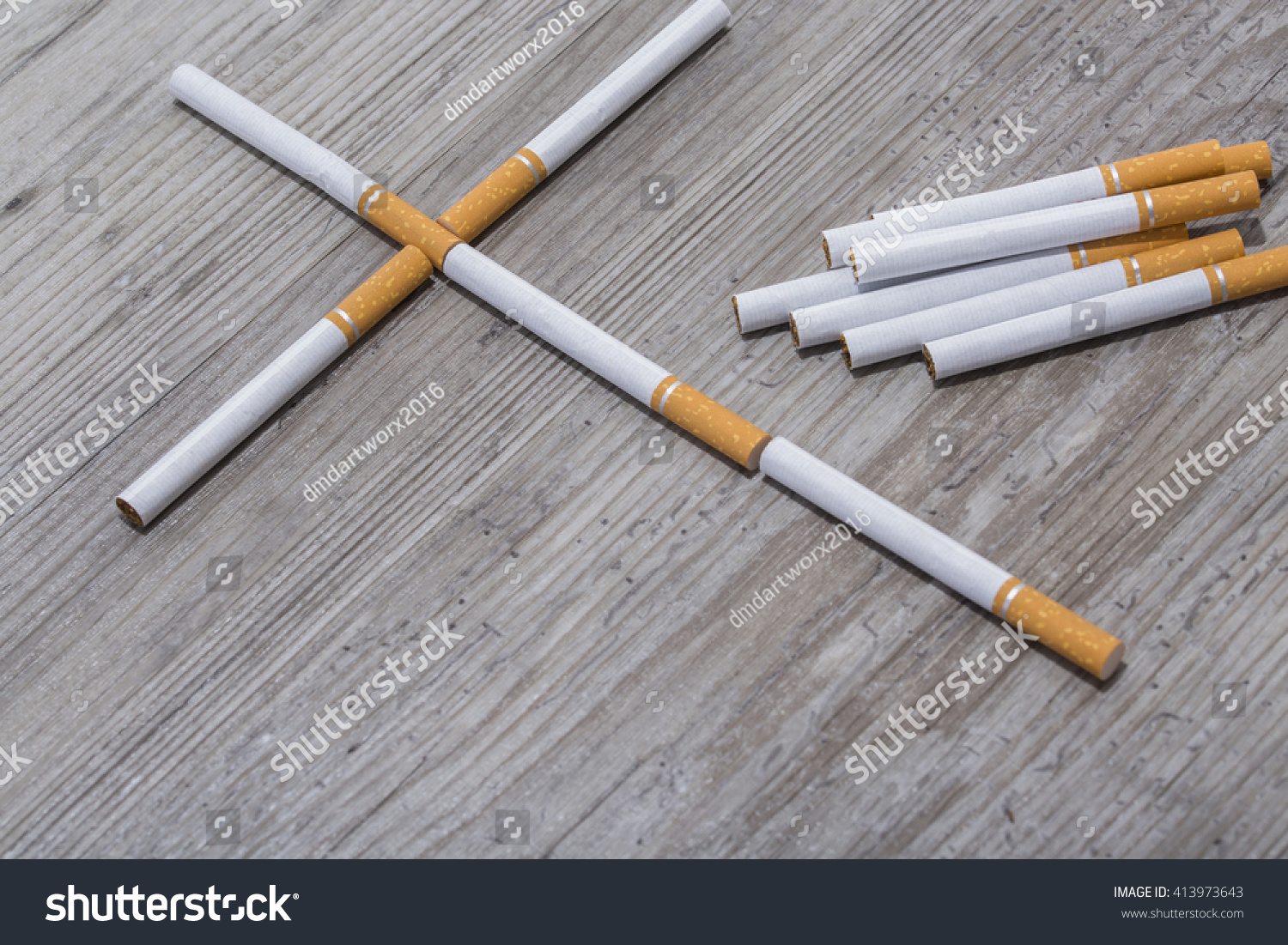 Amazing photo of Cigarettes Cross On Wooden Background Stock Photo 413973643  with #996B32 color and 1500x1101 pixels
