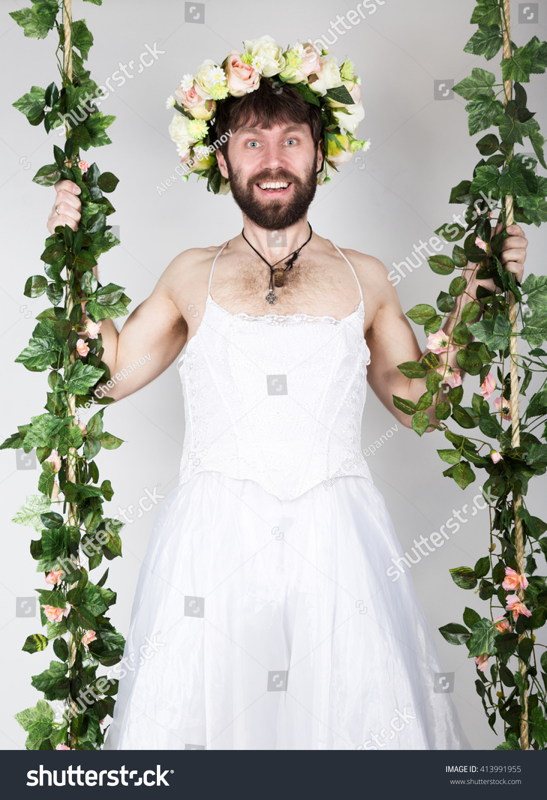 Bearded Man In A Womans Wedding Dress On Her Naked Body Clinging To The Vine