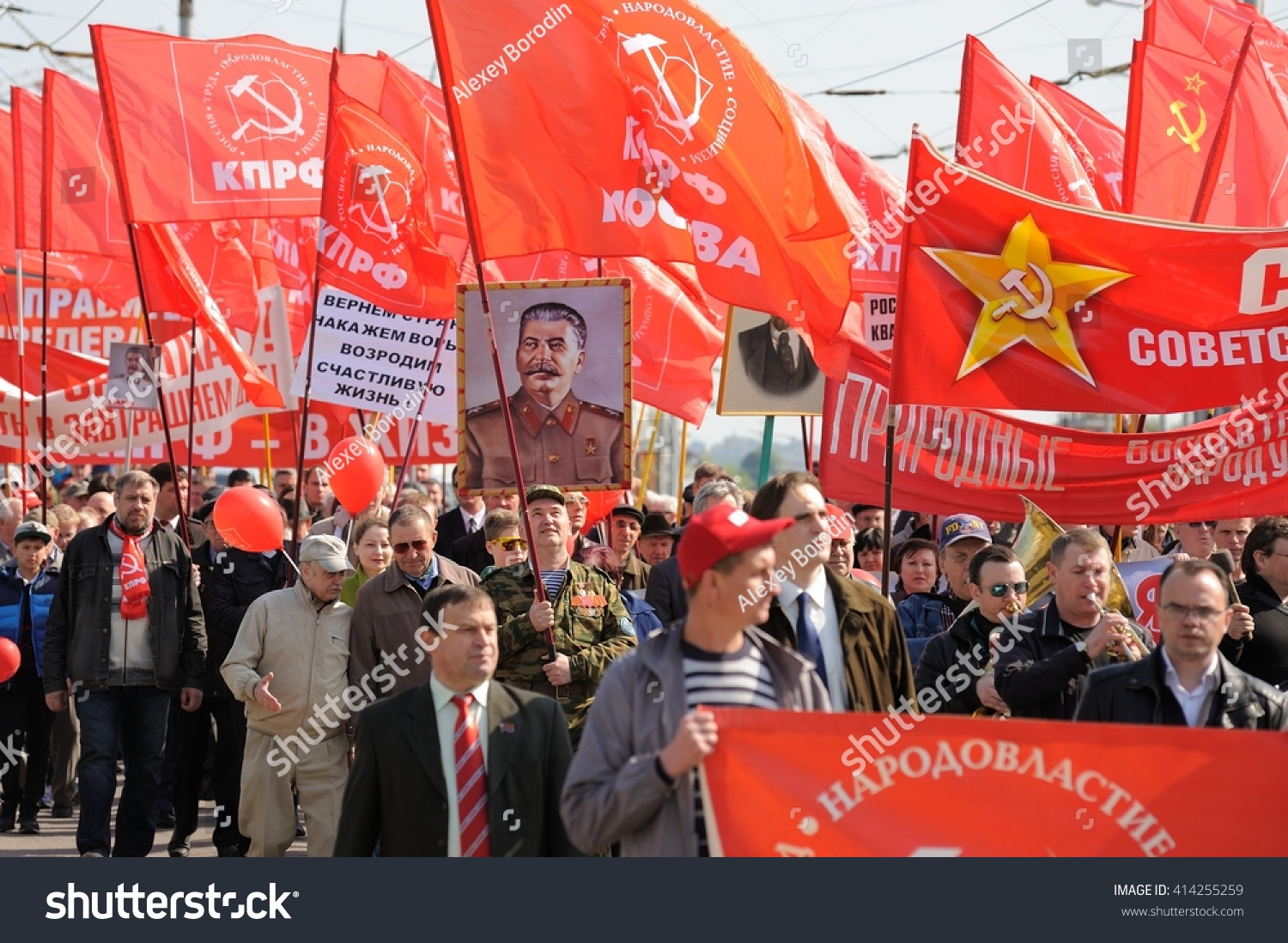 Orel, Russia - May 1, 2016: Communist party demonstration. People carrying red flags and Stalin's portrait