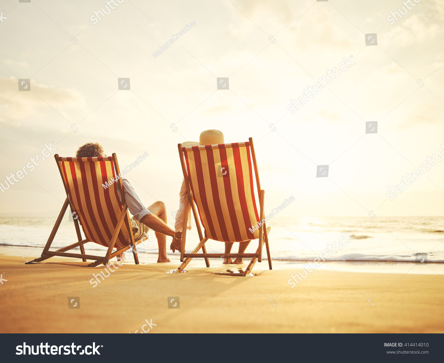 Retired Couple Watching Sunset Vintage Beach Stock Photo Edit Now 414414010