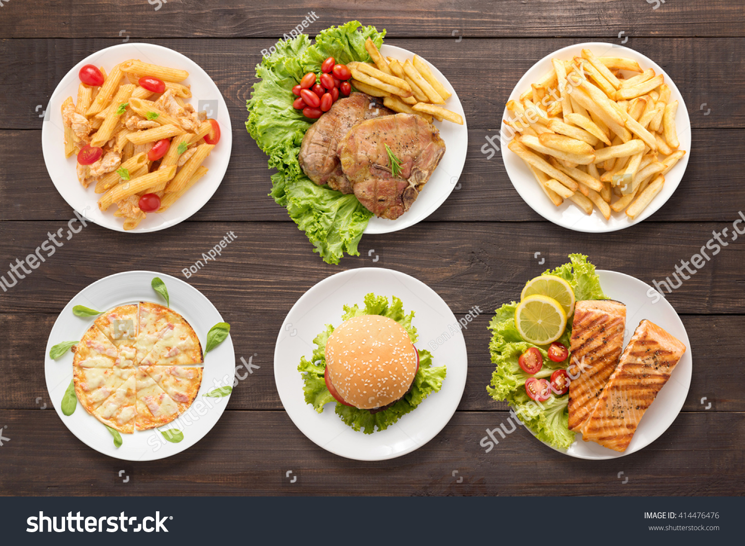 Food set pasta bbq meat french fries pizza burger and bbq salmon on the wooden background