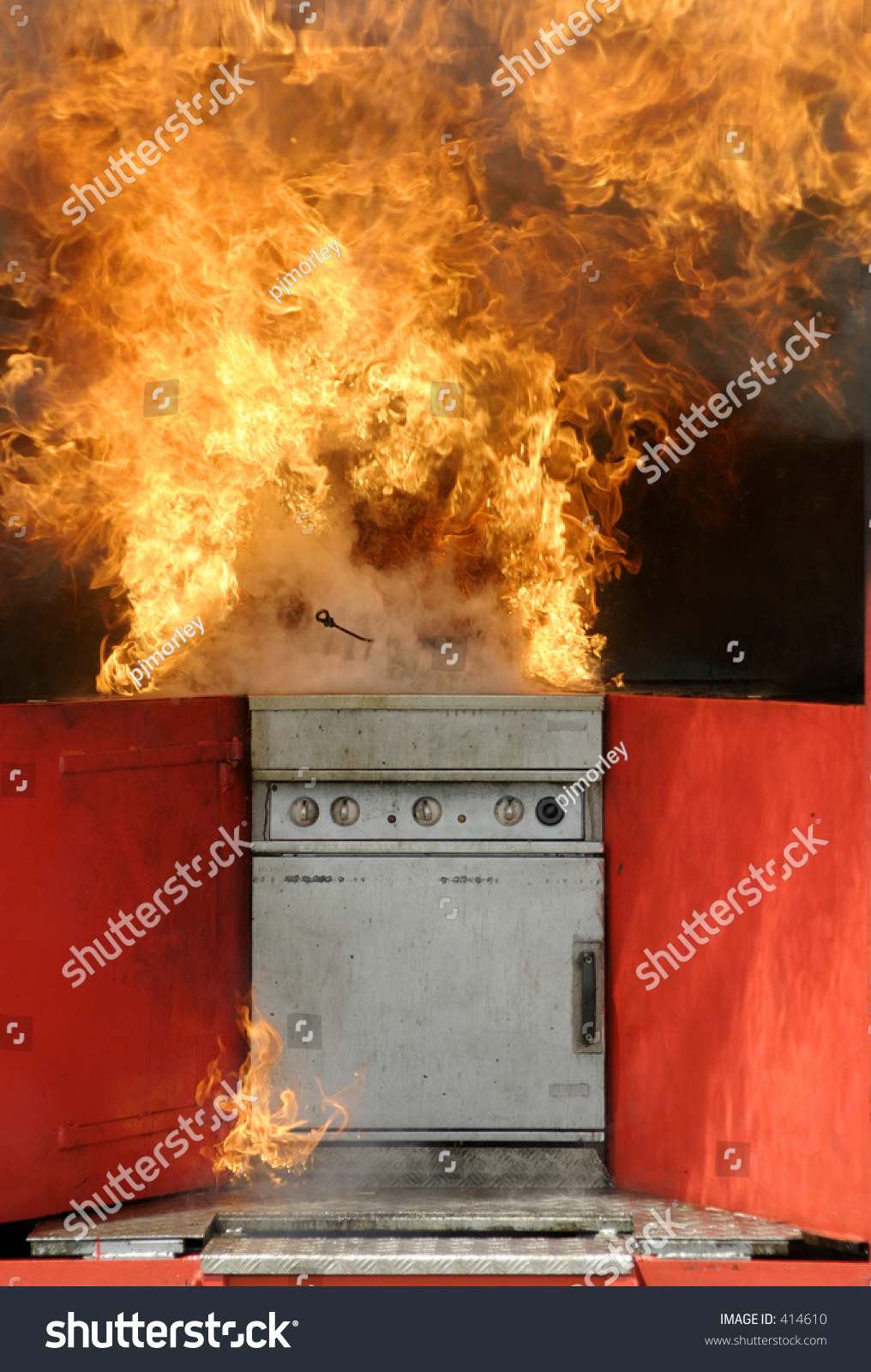 kitchen fire result trying put out stock photo 414610 shutterstock. Black Bedroom Furniture Sets. Home Design Ideas