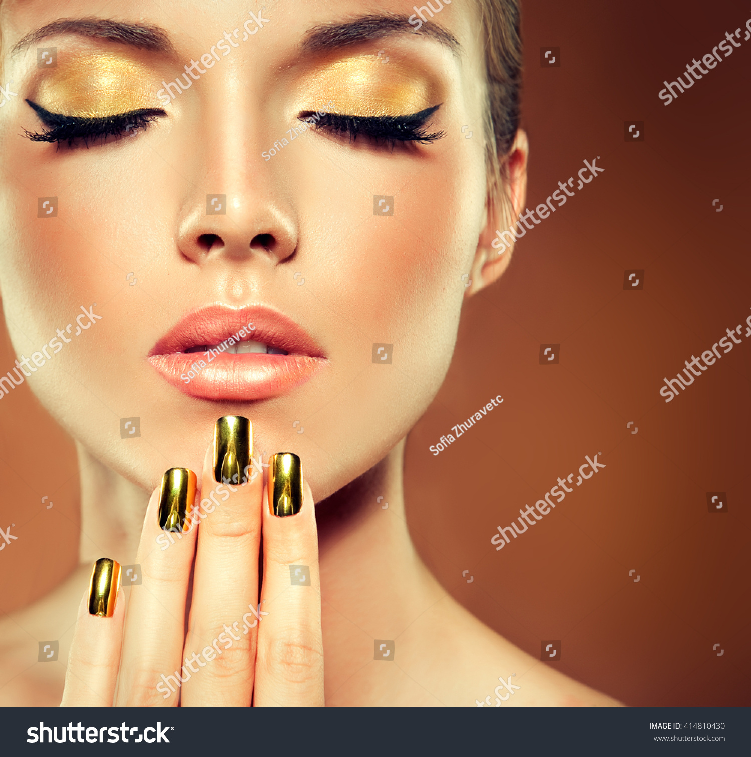 A Nail Art Beauty Salon Fashion Makeover Game For Girls: Girl Model Golden Makeup Gold Metal Stock Photo 414810430
