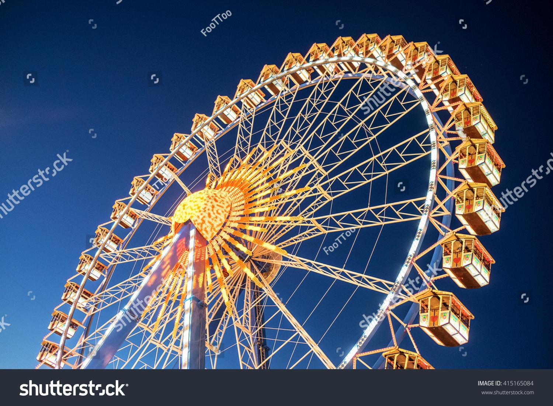 famous ferris wheel at the oktoberfest in munich - germany #415165084