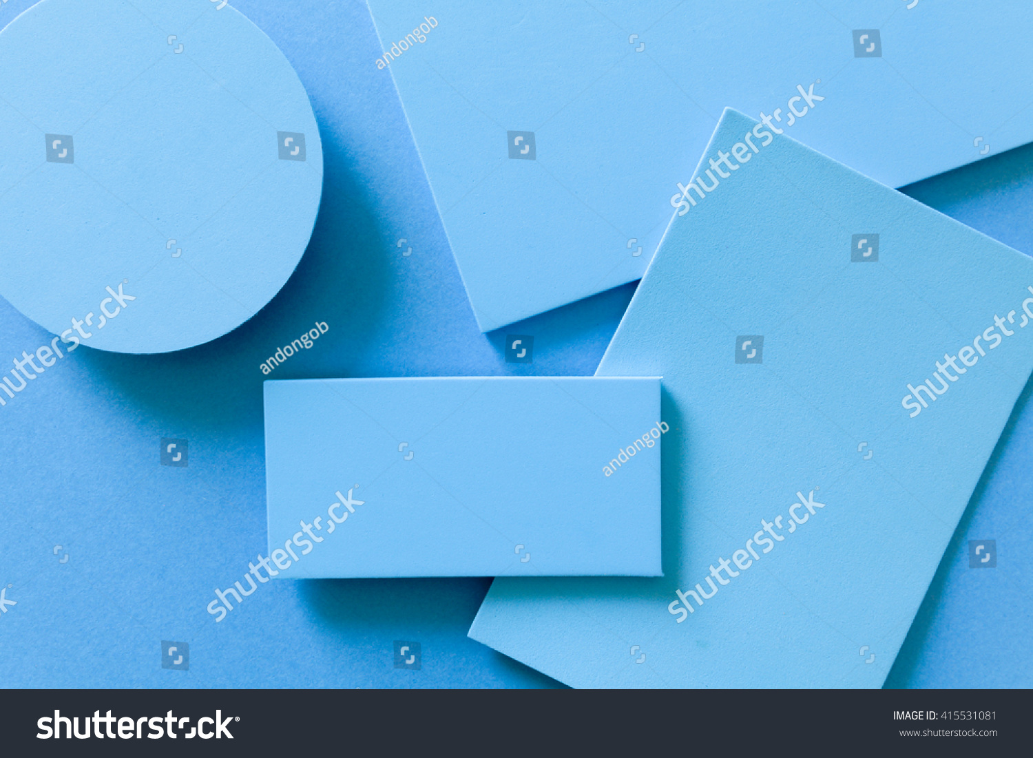 Monochromatic blue background with geometric shapes shaded imitating the  material design