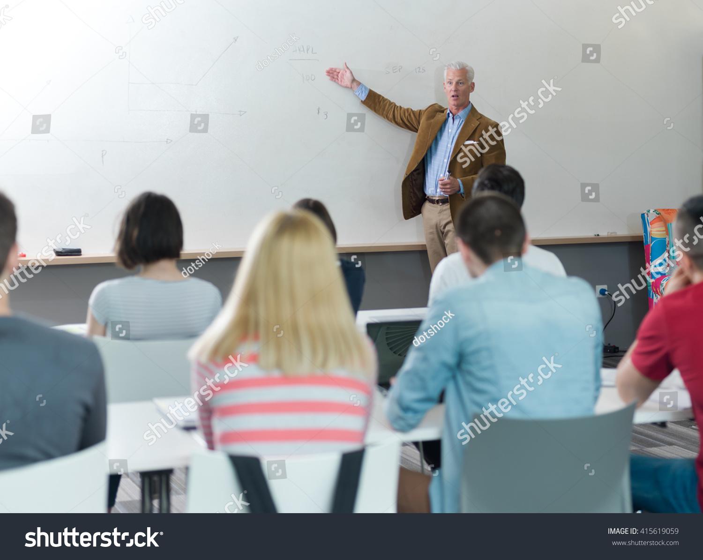 Modern Classroom Teacher ~ Senior teacher group happy students modern stock photo
