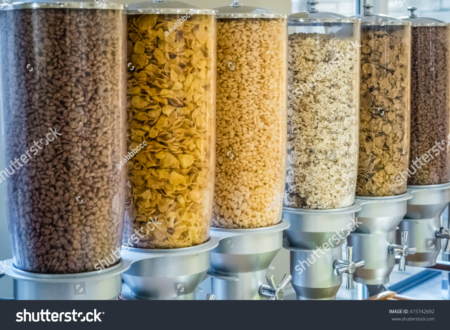 Cereal dispensers offering various kind cereals stock photo cereal dispensers offering various kind of cereals on a self service breakfast counter in a hotel ccuart Images