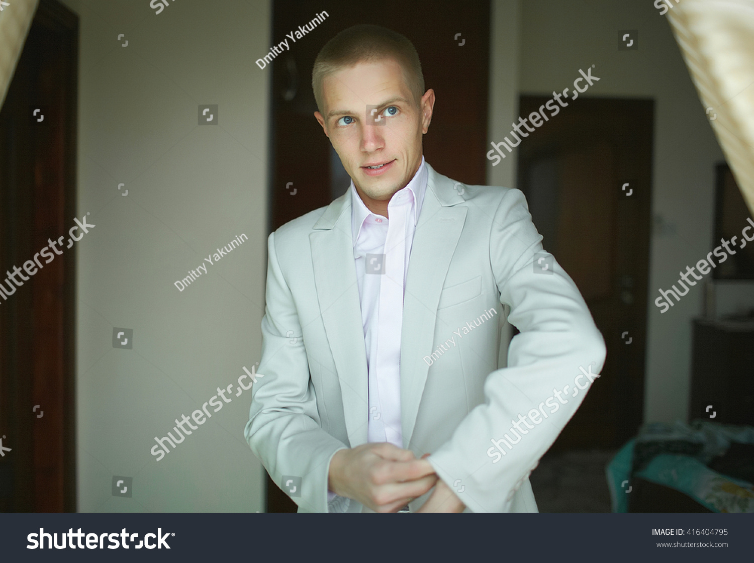 Handsome Strong Man Putting On Official Stock Photo 416404795 ...