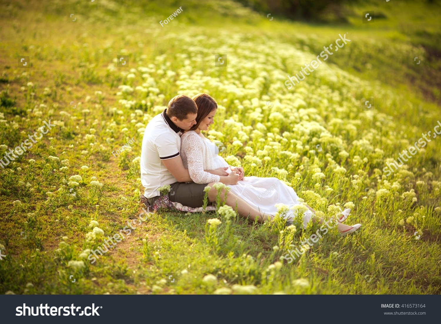 Beautiful pregnant woman her husband green stock photo for Gardening while pregnant