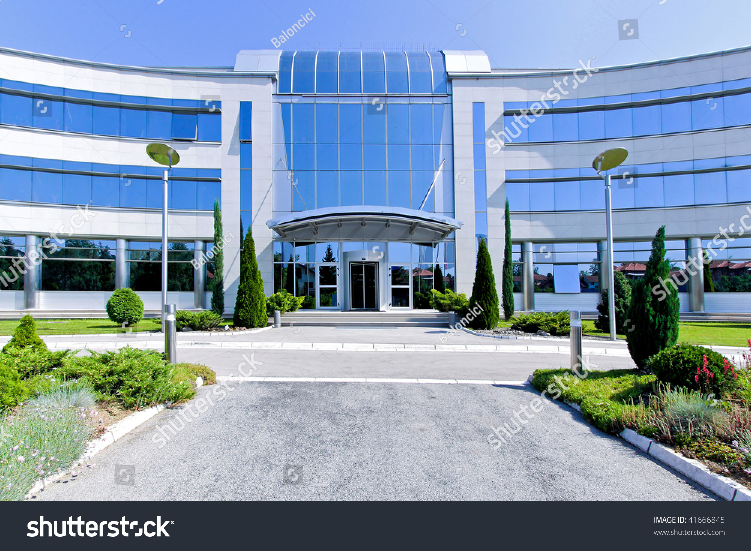 Front view of blue glass office building stock photo for Exterior view of building