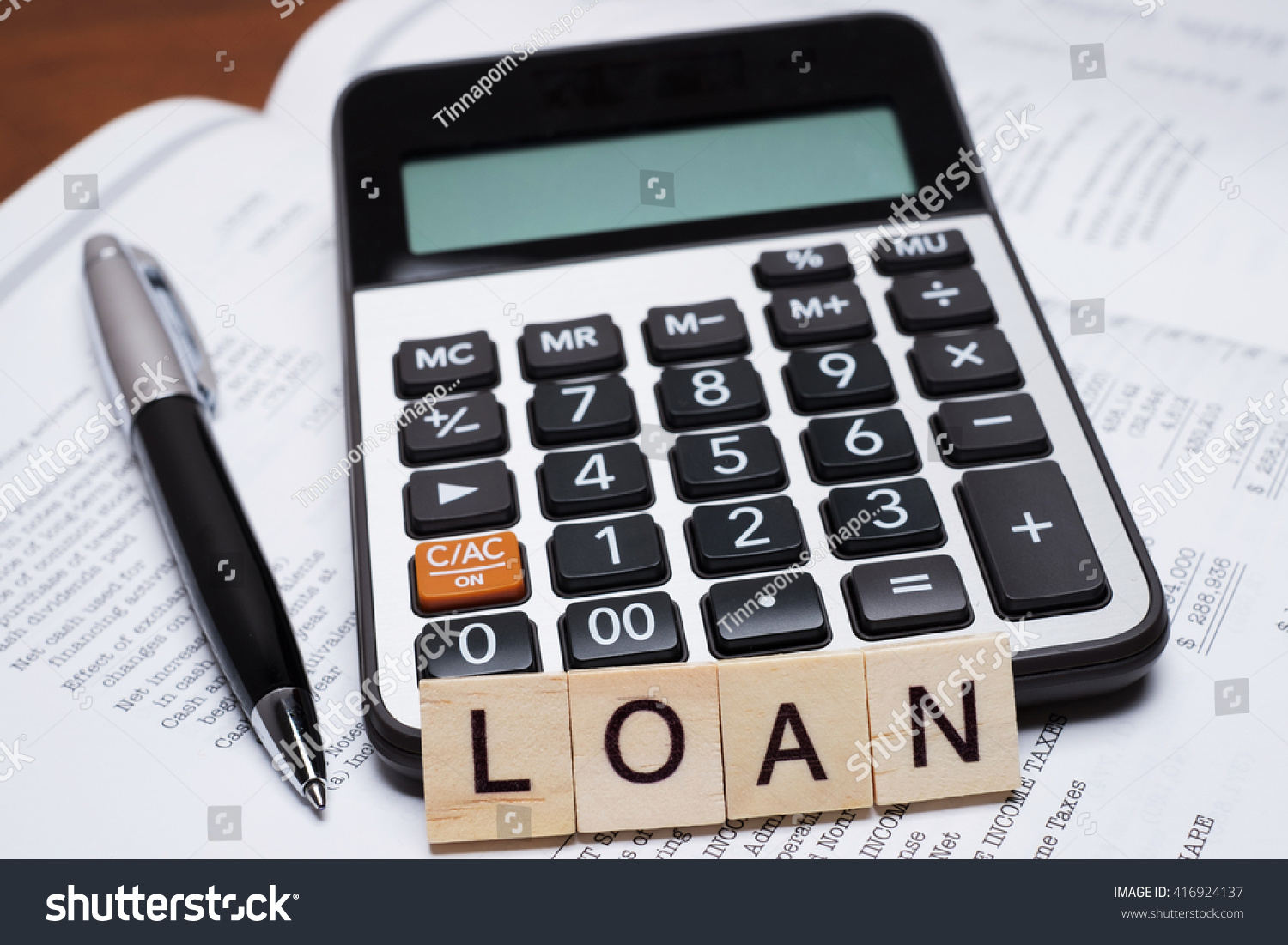 calculator word loan written wooden block stock photo (edit now
