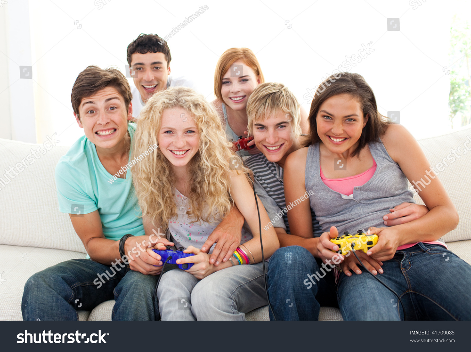 friends having fun playing video games in the living room stock photo 41709085 shutterstock. Black Bedroom Furniture Sets. Home Design Ideas