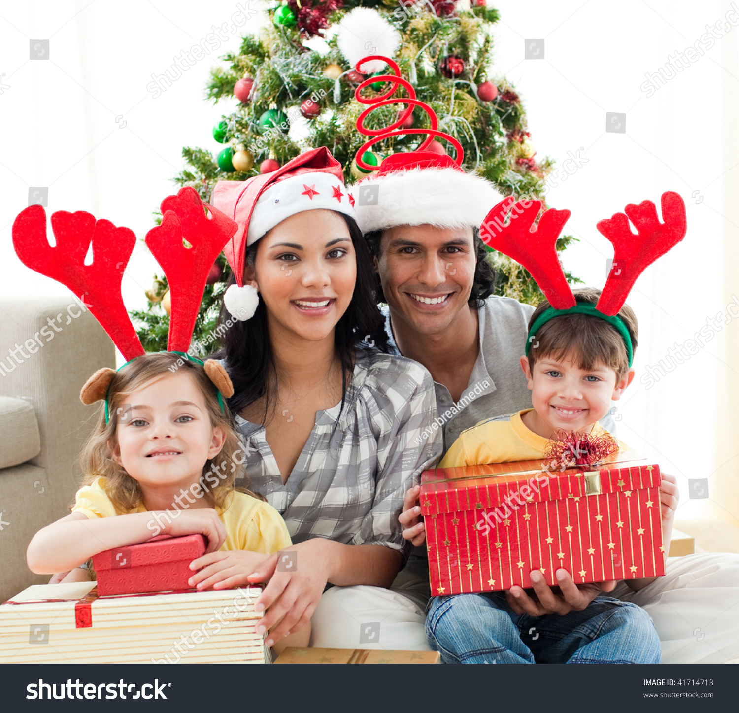 Happy Family Holding Christmas Gifts Home Stock Photo (Edit Now ...