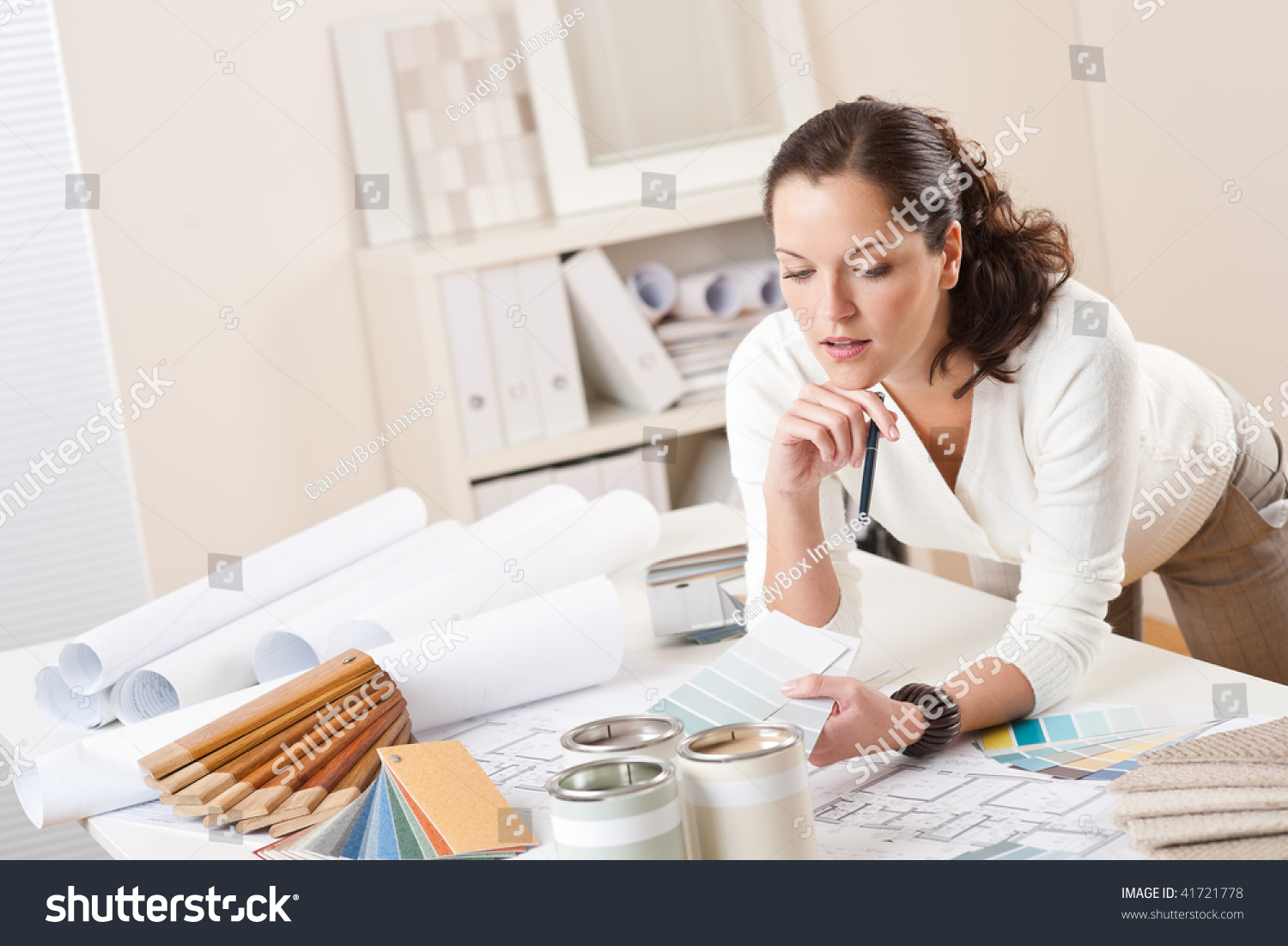 Female Interior Designer Working At Office With Color