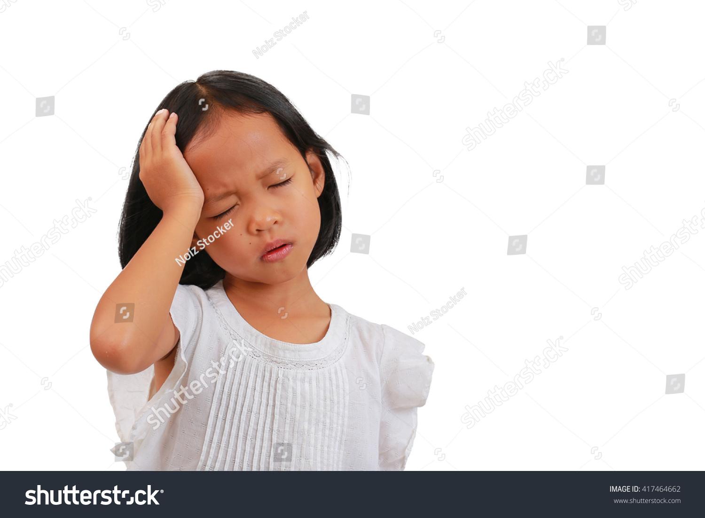 asian small girl suffering from severe headache, migraine or vertigo,  stressed asian girl child