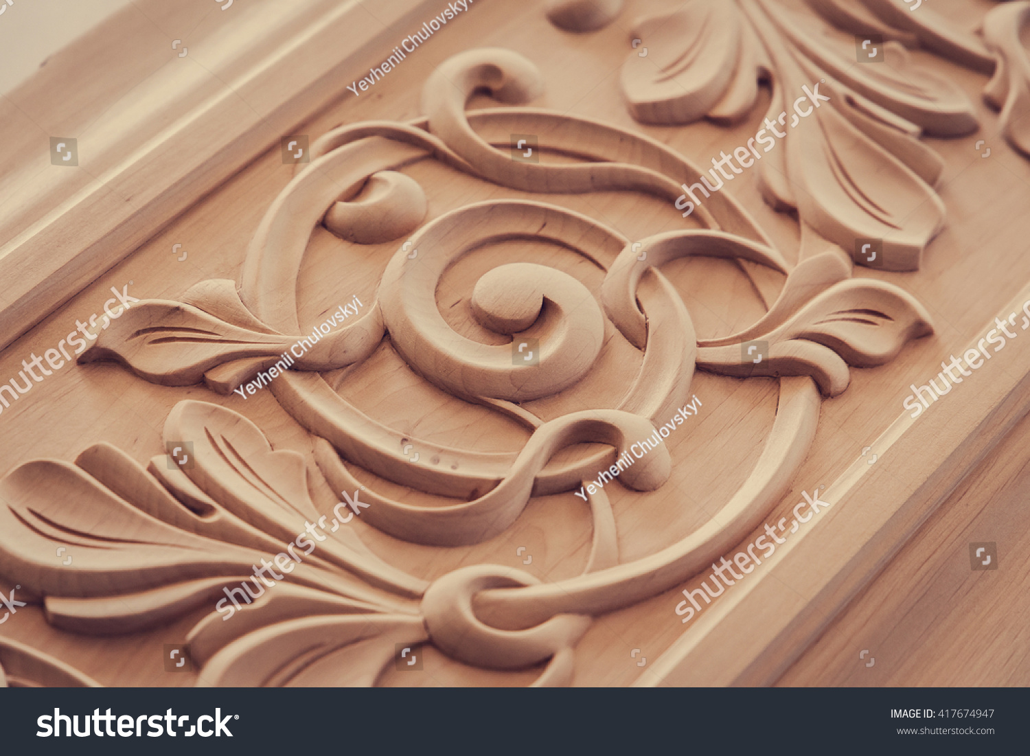 stock photo wood processing joinery work wood carving decorative abstract floral ornament pattern of