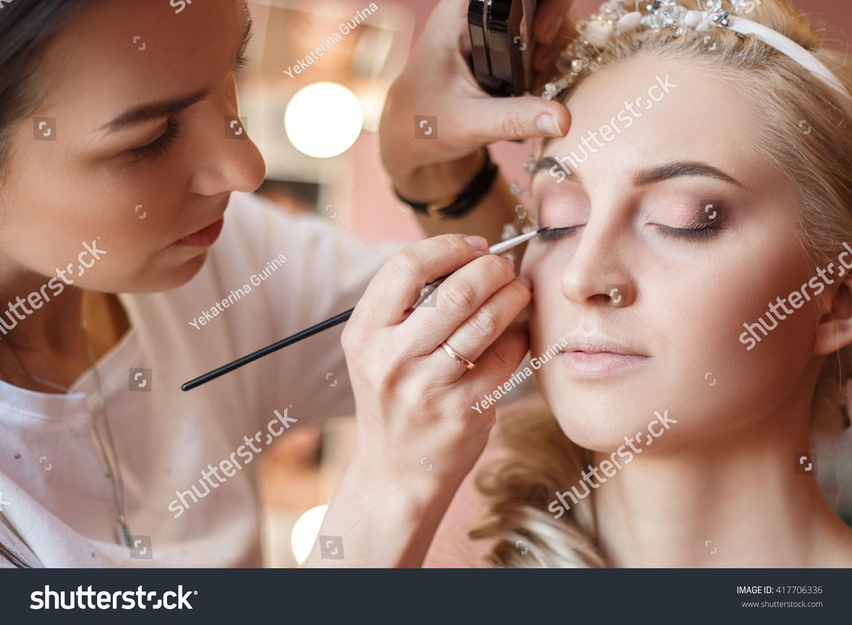 Makeup artist doing makeup for models for a photo shoot