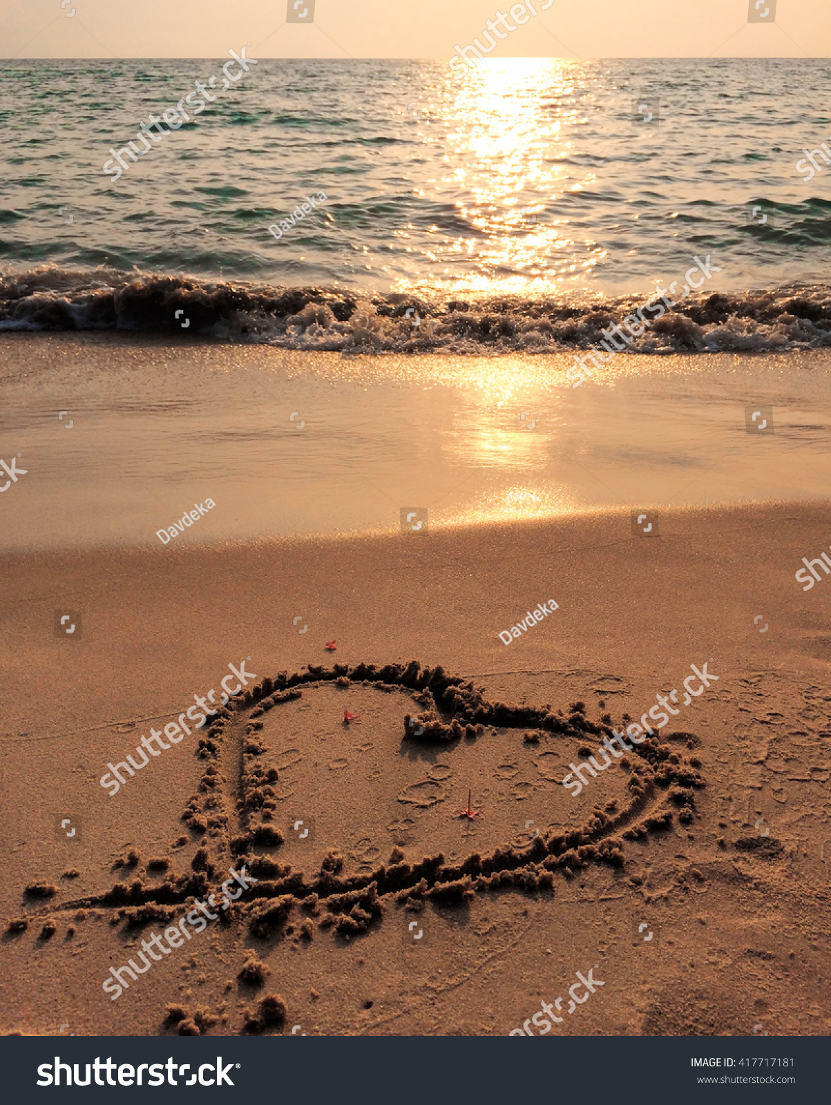 Sunset Sea Heart On The Beach And Blue Wave Sand Of