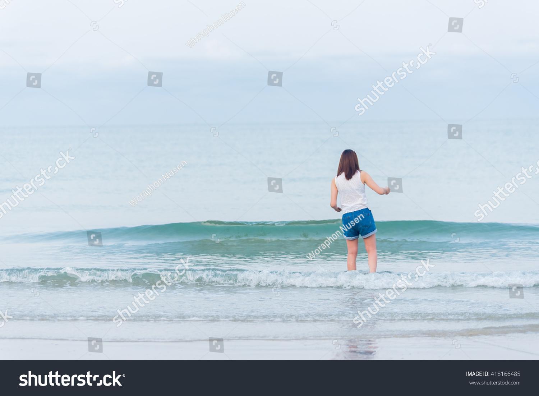 Girl Standing On Beach Stock Photo - 348.8KB