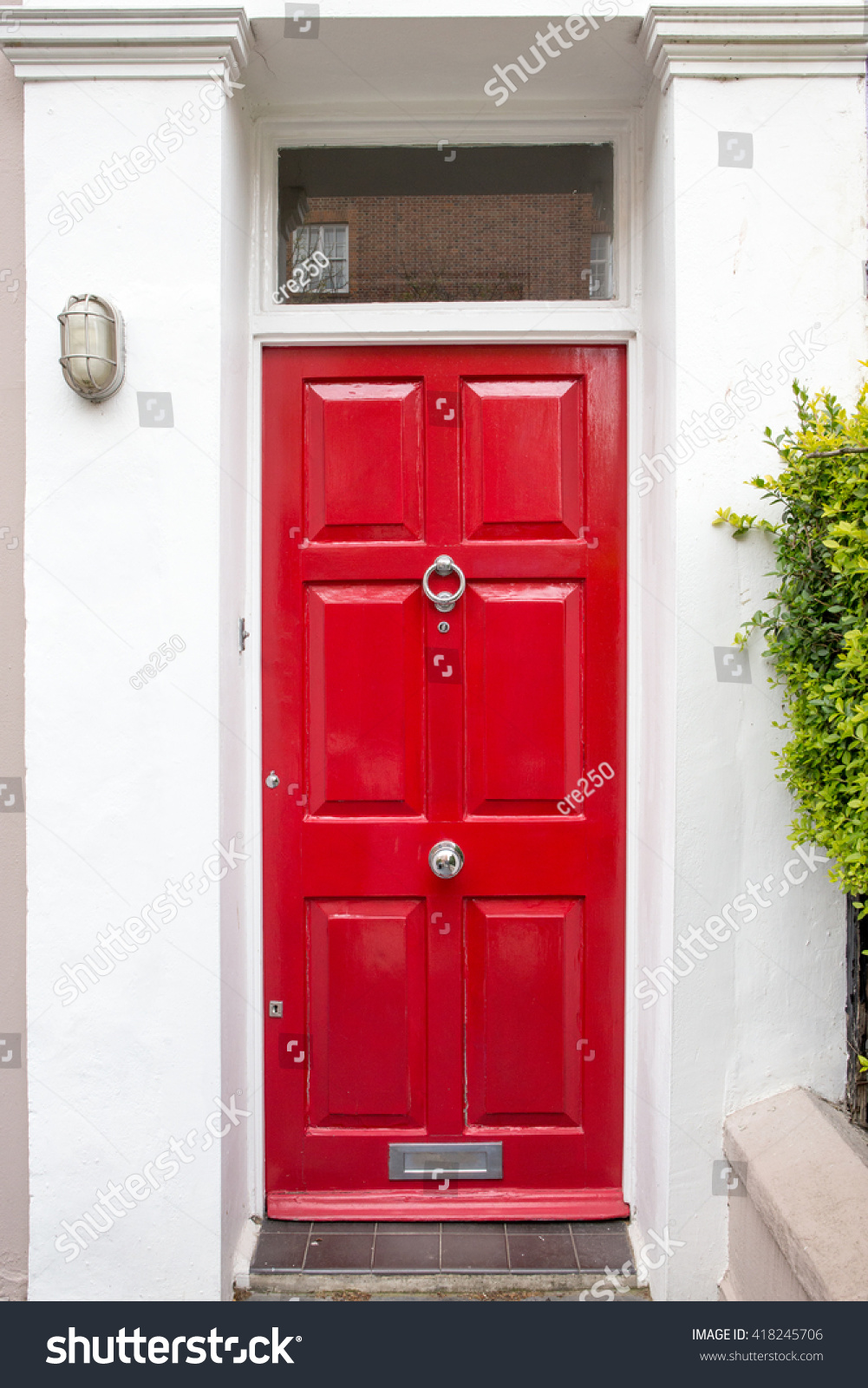 Red Front Door Of A Beautiful Old English Town House Ez Canvas