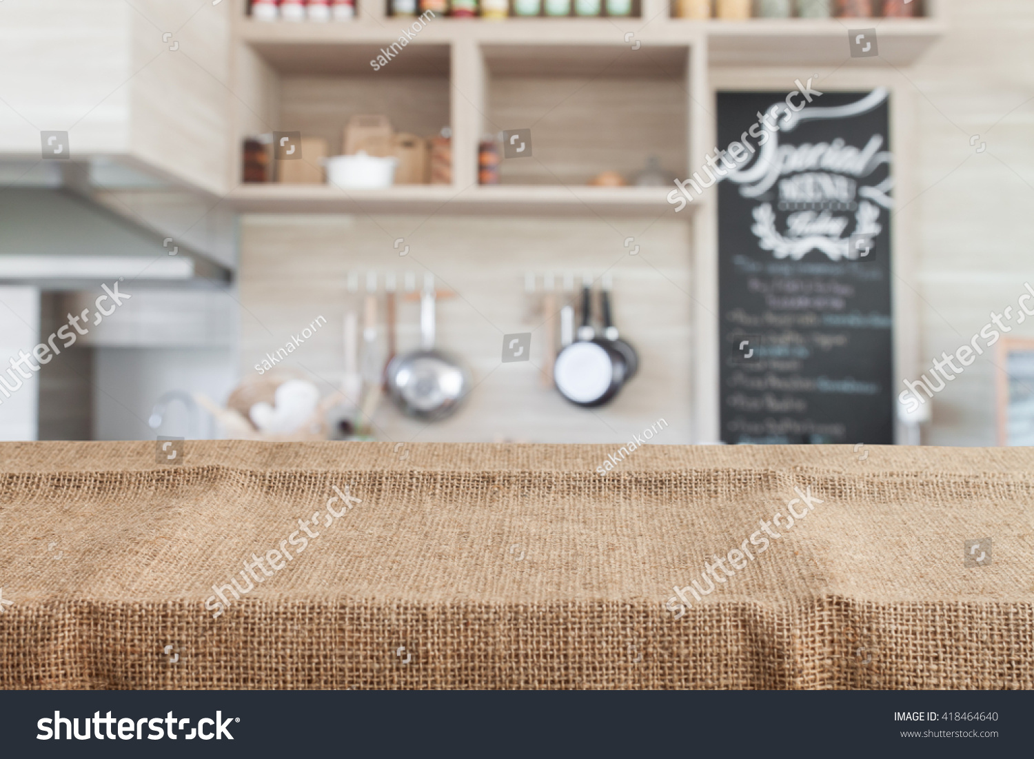 Empty wood table and blurred living room background stock photo - Burlap On Wood Table Top With Blur Kitchen Background Empty Wooden Table For Product Display