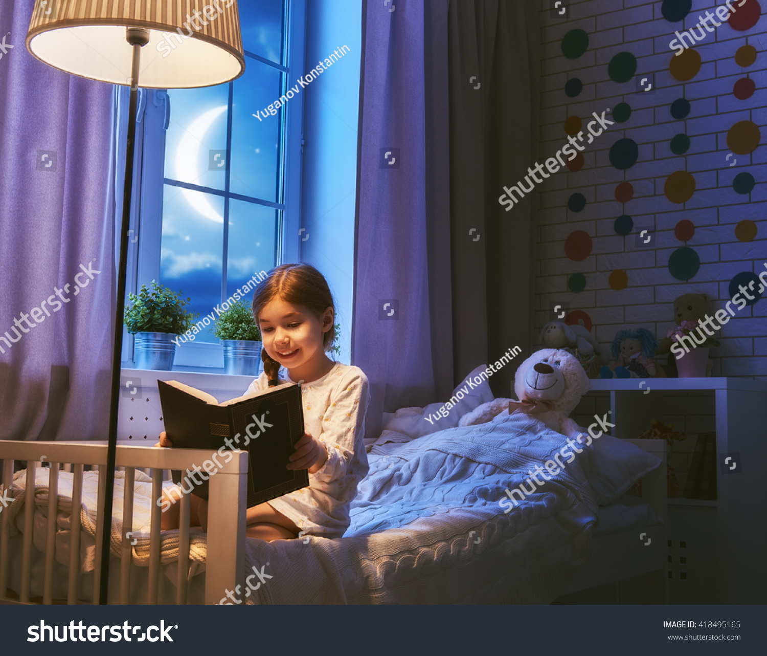 cute little child girl reading book stock photo