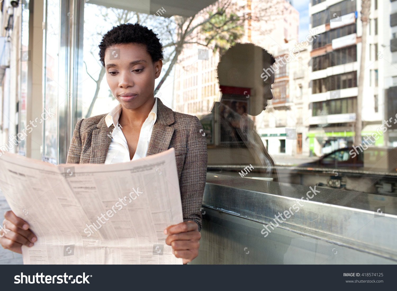 beautiful african american business woman reading stock photo (edit