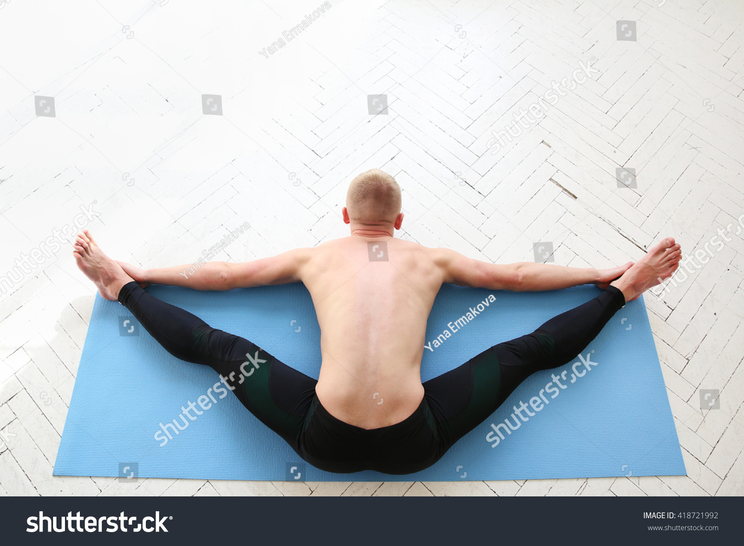 Sporty Man Practicing Yoga Upavistha Konasana Wide Angle Seated Forward Bend Top View Stock Photo