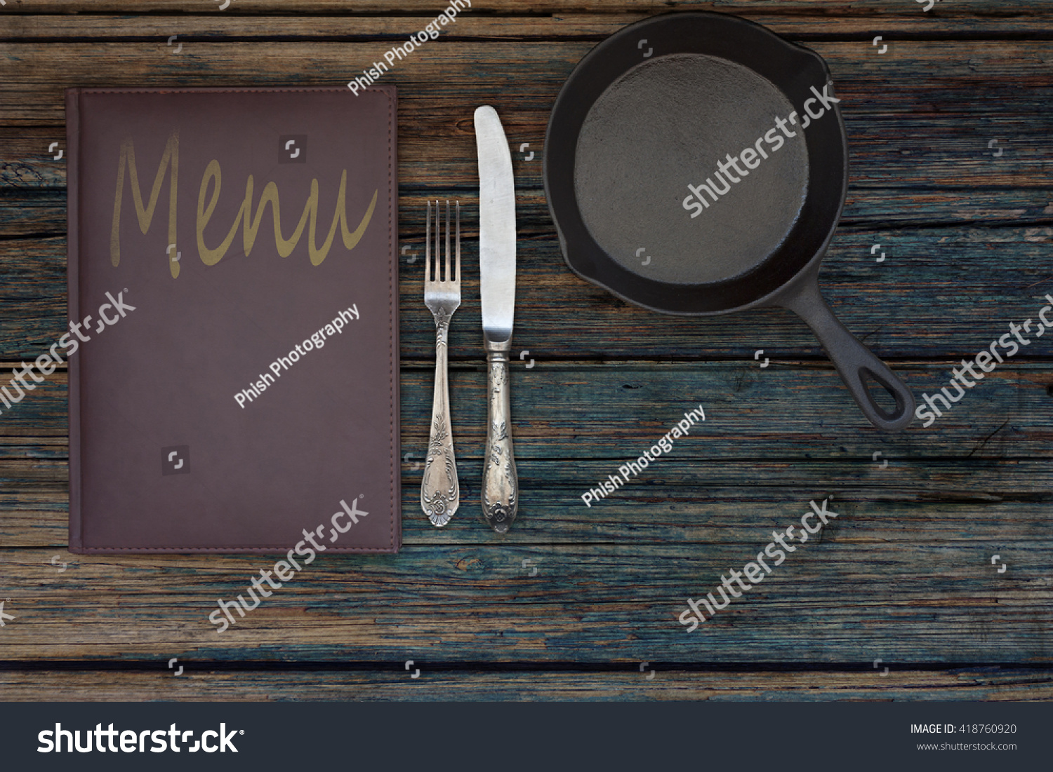 Vintage leather restaurant or cafe food menu with silverware or cutlery  including a fork and a