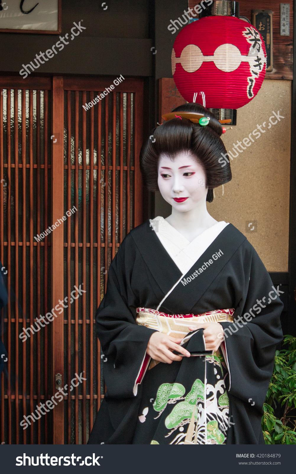 Kyoto,Japan. November 25, 2010. Geisha Mamehana in front of her Ochaya