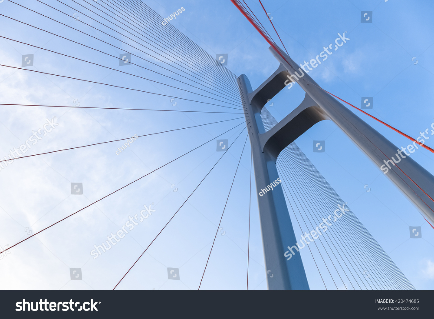 cable stayed bridge closeup against blue sky , upward view #420474685