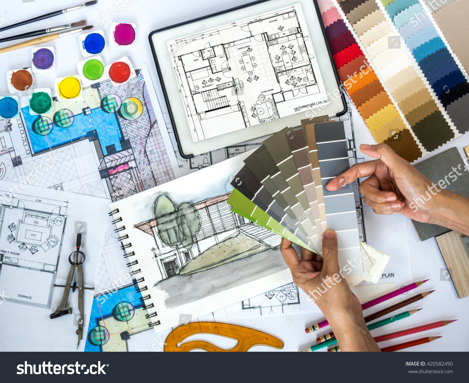 Top view of architect \u0026 interior designer working at worktable with color swatch tablet