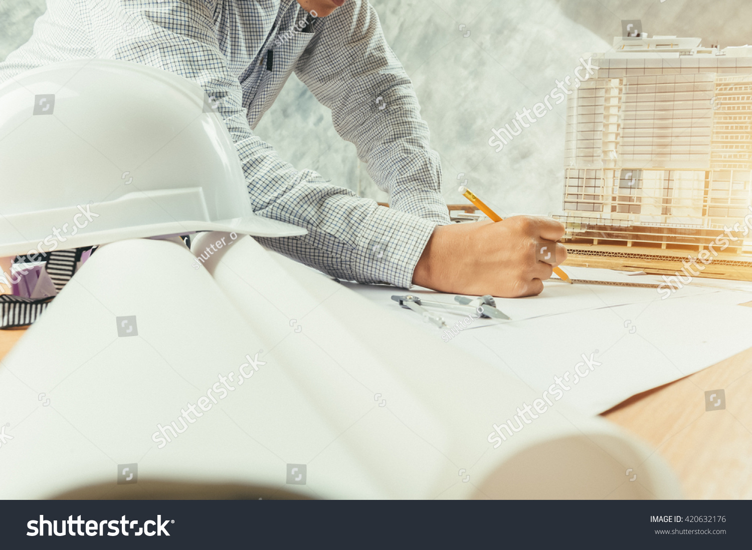 Architect working on blueprint architects workplace stock photo architect working on blueprint architects workplace architectural project blueprints ruler helmet malvernweather Gallery