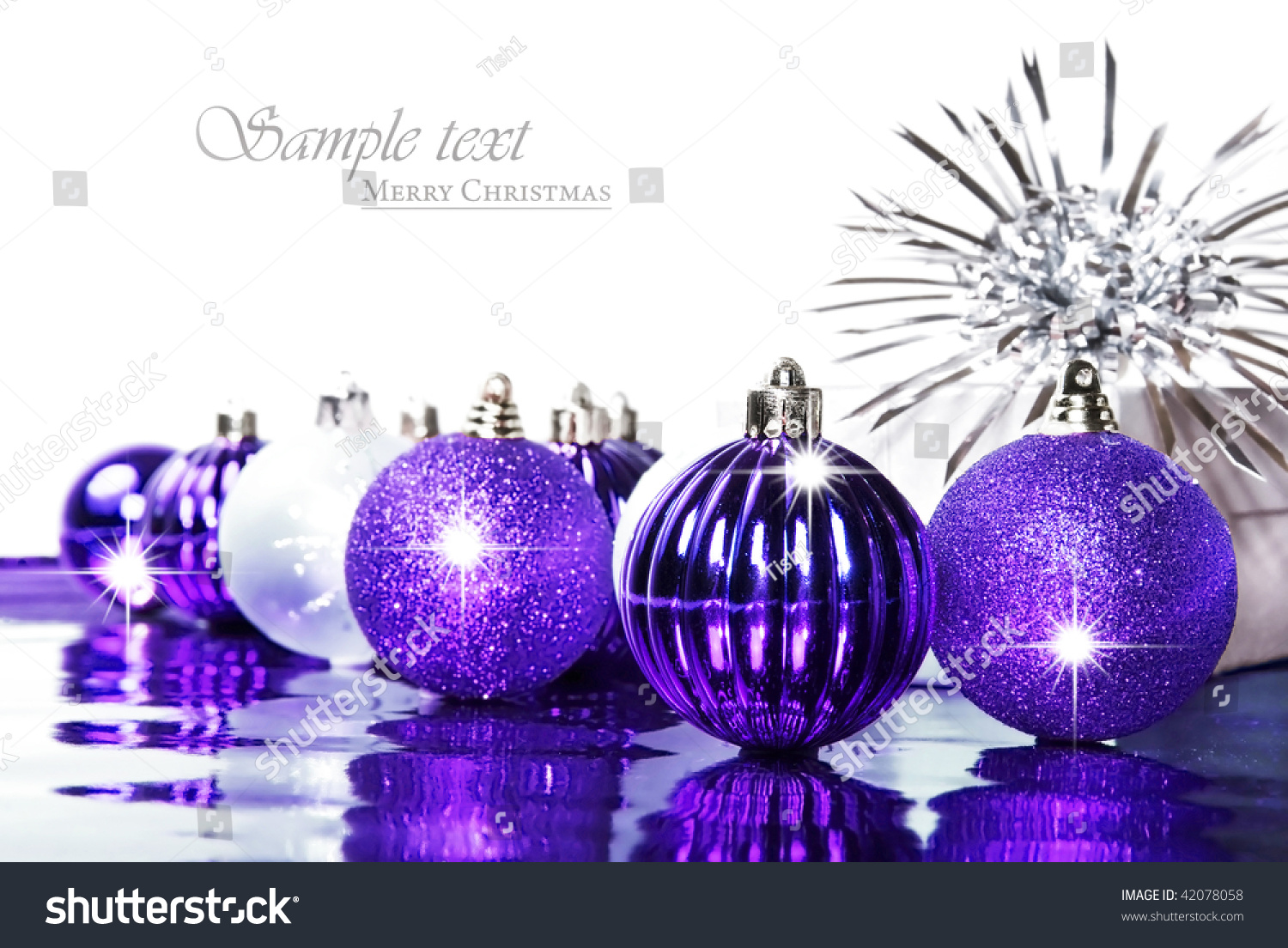silver and purple christmas decorations with space for text