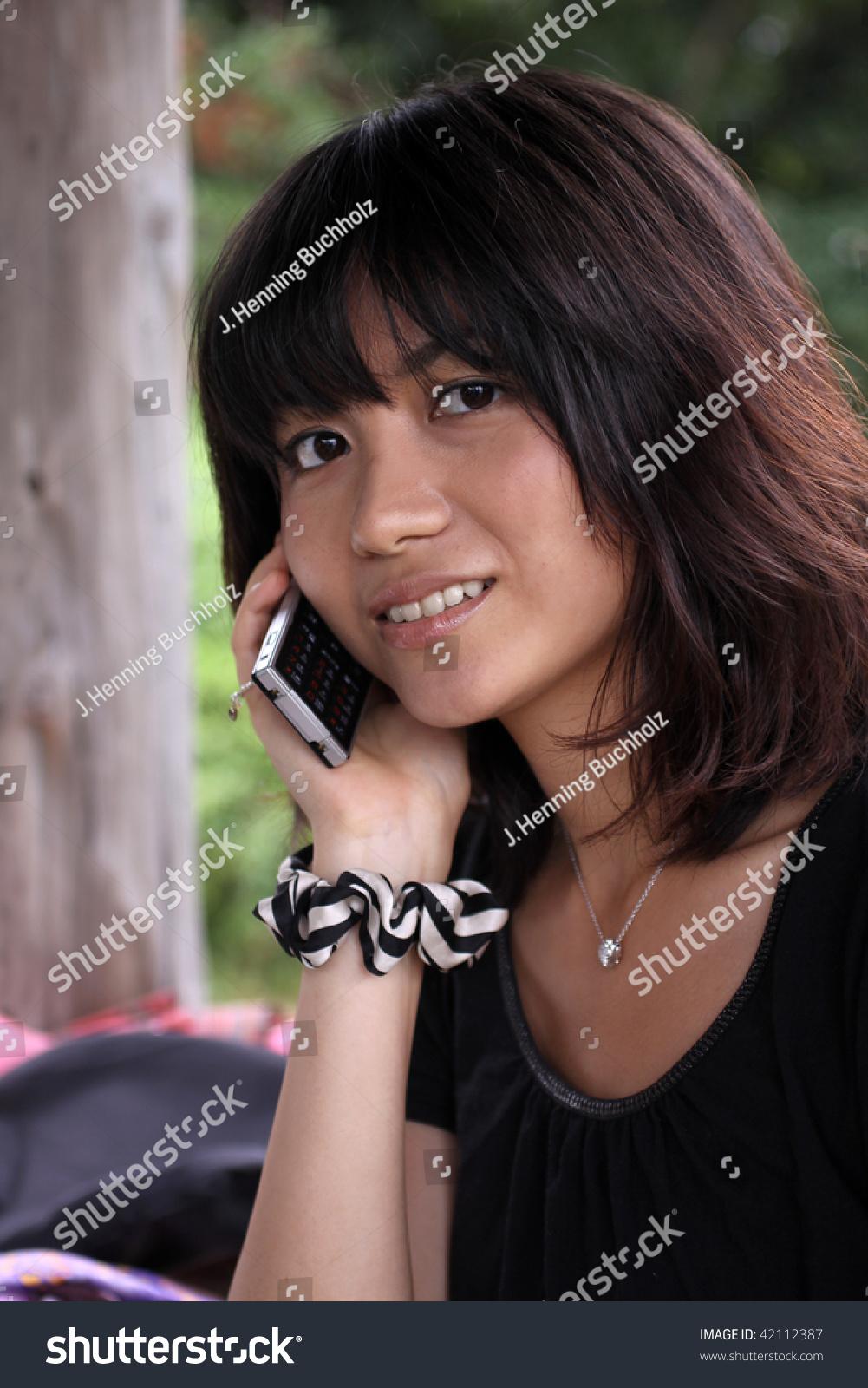 beautiful japanese girl talking on cellphone stock photo (edit now