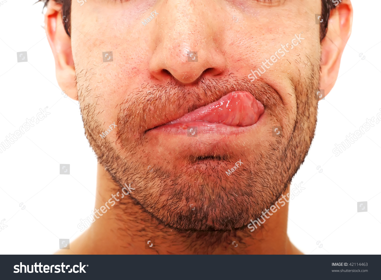 Closeup of a man's face with his tongue out
