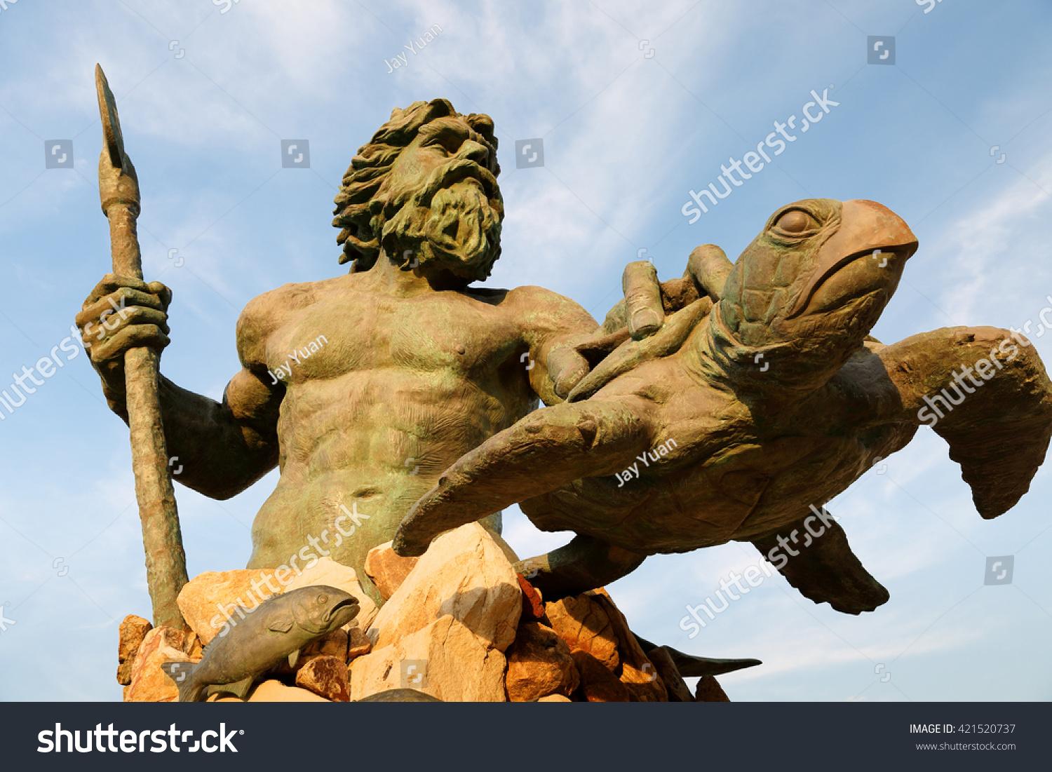 Virginia Beach Virginia April 20 2016 The King Neptune Statue at Virginia Beach Before Sunset King Neptune is a large bronze statue sculpted located in Virginia Beach Virginia