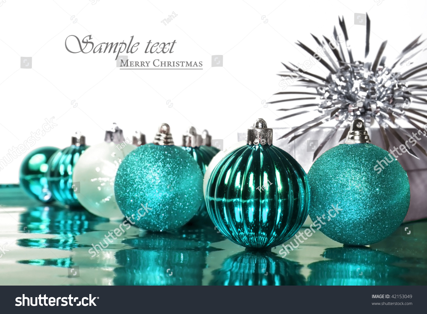 turquoise blue christmas decorations with stars on a white background with space for text